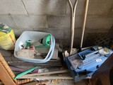 Tools in toolbox, hand tools, sprinklers etc