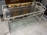 Wrought metal and glass garden table