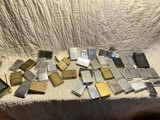 Large Group of Plain Zippo lighters