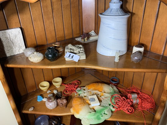 Assorted cabinet contents including Asian items