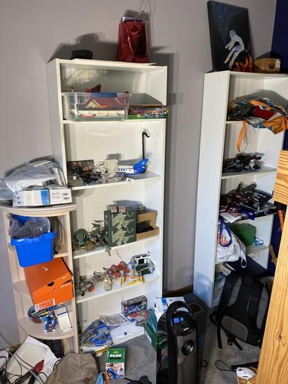 Two tall shelves and a corner shelf