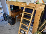 Heavy timber loft bed with ladder