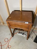 Vintage sewing machine in stand