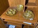 Shelf lot of yellow depression glass