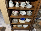 Four shelves of antiques and vintage items