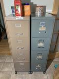 2 metal file cabinets plus tins