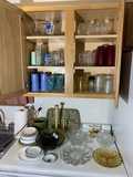 Cupboard contents and items on counter