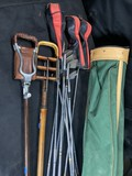 Group lot of vintage golf clubs plus two portable spike seats