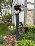 Vertical kinetic metal outdoor sculpture