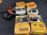 Group of tobacco pipes, fishing Reels in boxes