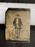 Early tintype of a man with Bicycle