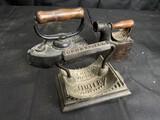 Two antique sad irons PLUS Geneva Fluter