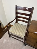 Antique armchair with woven seat
