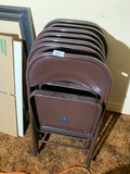Stack Of folding chairs
