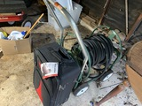 Suitcase, hose and reel
