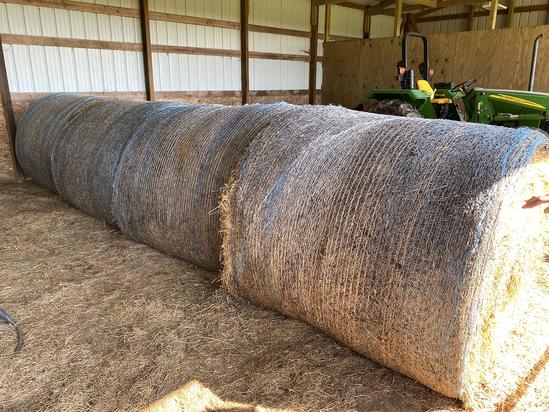 Four large hay bales