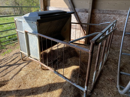 Metal and plastic cattle bale feeder