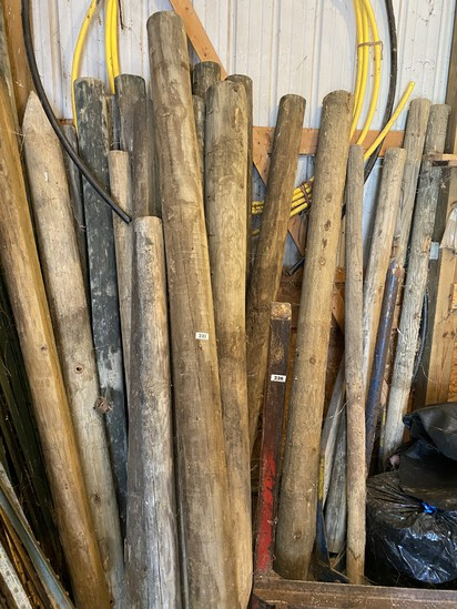 Group lot of heavy wooden posts