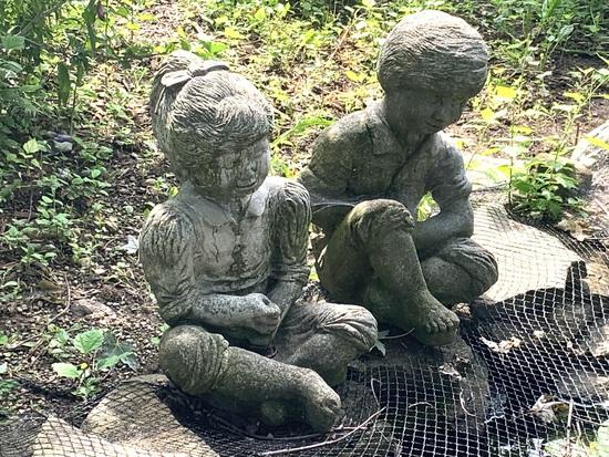 Boy & Girl Cement Statues