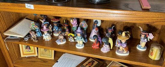 Shelf lot of southwest Native American Hummel Figurines