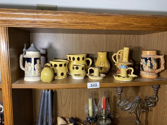Shelf lot of decorative pottery, steins
