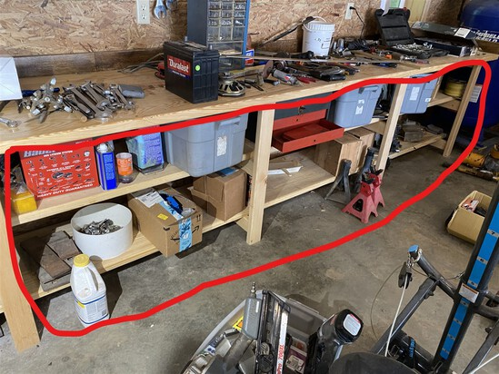 Group lot of misc items under the tool bench