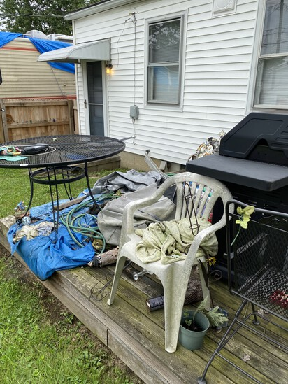 Patio furniture, barbeque Grill etc on porch