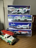 Group of 5 Hess Trucks.  See Photos.