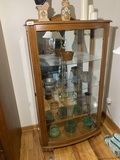 Curved Front Curio Cabinet with Pottery