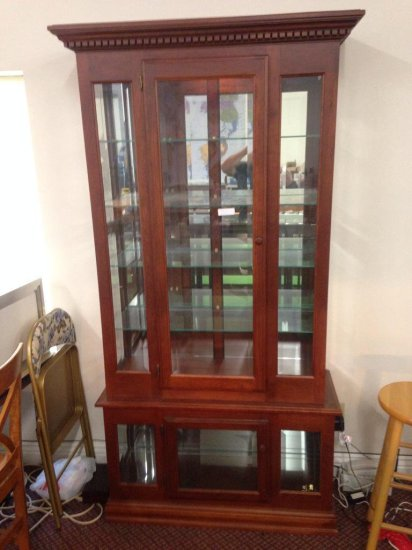 Lighted Two-piece Cherry Finish Glass Wall Cabinet
