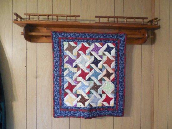 Vintage Quilt On Wooden Rack