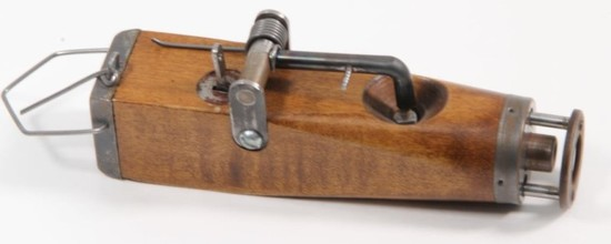 *Mole trap gun. Constructed of wood and metal