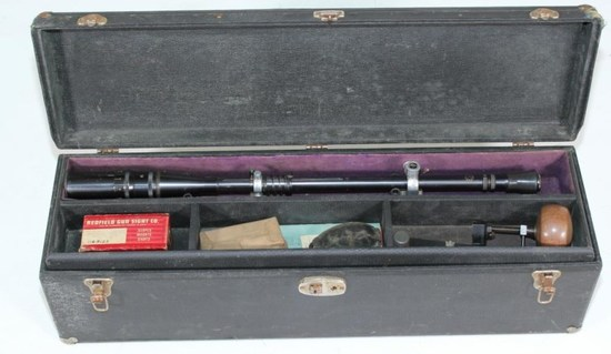 "Cased J. Unertl 16x 3/4"" tube rifle scope with metal lens covers and black composite eye relief cup."