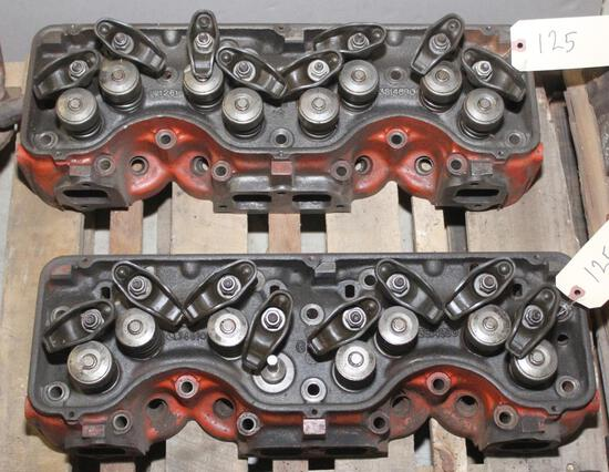3 Chevy 409 stock cylinder heads,1 is bare