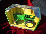 NEW IN BOX JOHN DEERE MODEL 4620 TOY TRACTOR- BRIGHT AND CLEAN