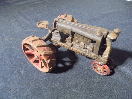 """ANTIQUE CAST IRON TOY """"MC CORMICK-DEERING"""" TOY TRACTOR"""