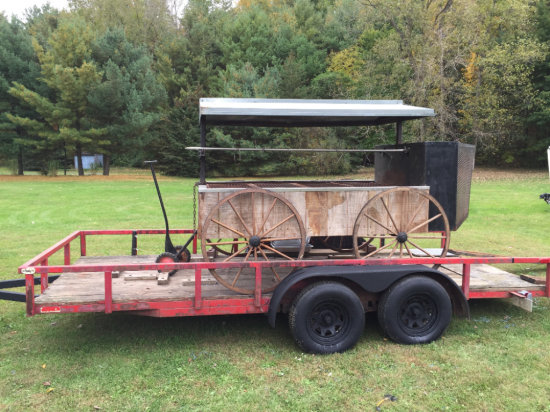 Custom wagon style rotisserie with 16ft tandem axle trailer