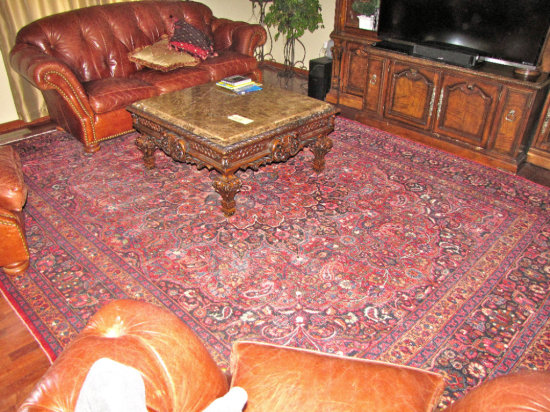 "large floor rug - 13'9""x10'11"" (damaged on corner)"