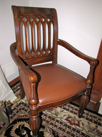 Pair leather arm chairs