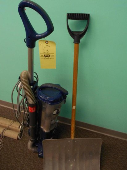 Vacuum cleaner and snow shovel
