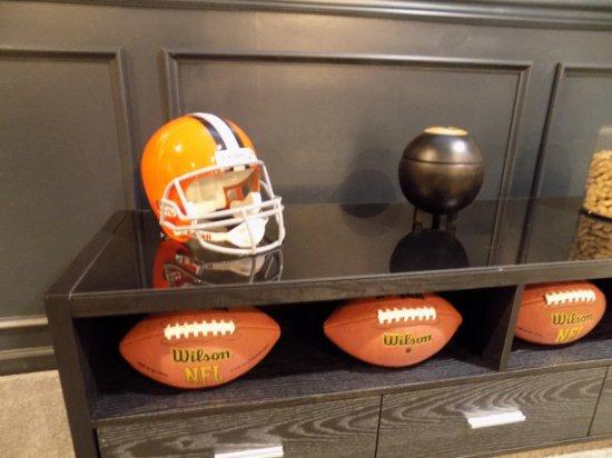 Browns helmet, 8 ball, footballs, jar of peanuts