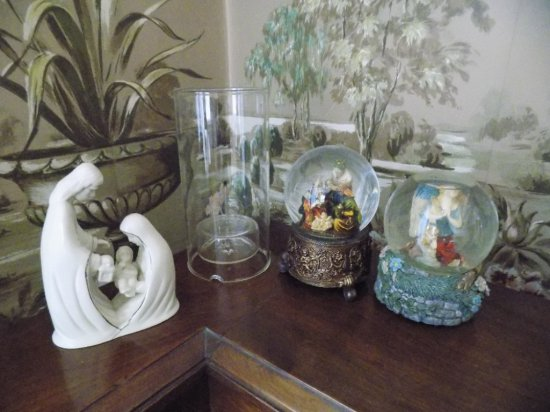 (2) Snow globes, candle, religious statue