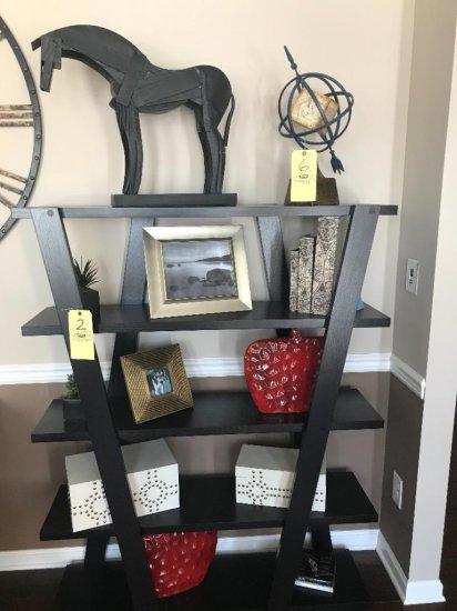 Contents of bookshelf, metal horse, decor