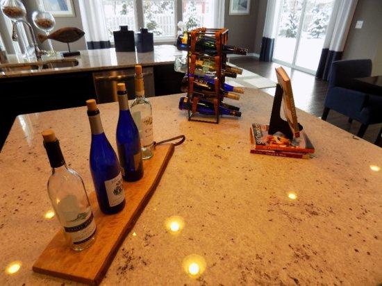 Wine rack, cutting board, and cookbook holder
