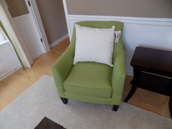 Green Upholstered Arm Chair with Accent Pillow