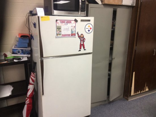 General Electric refrigerator and metal cabinet. Contents not included