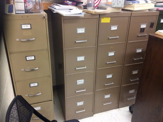 Seven filing cabinets, wooden bookcase, student table. Contents not included