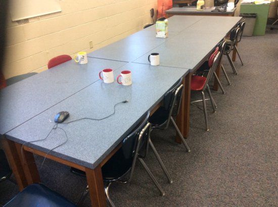 11 student tables and 23 student chairs.