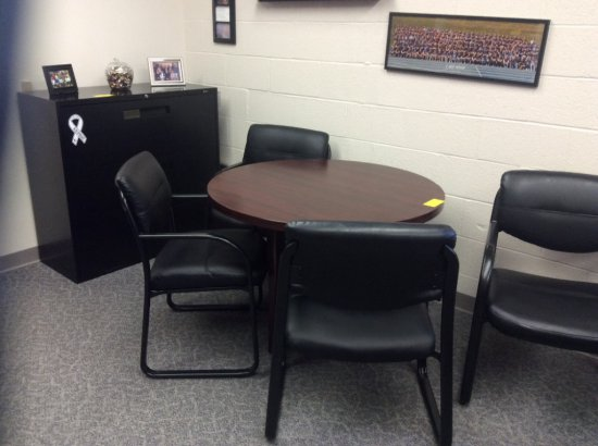 Table with four chairs, metal filing cabinet, wooden storage cabinet. Contents not included