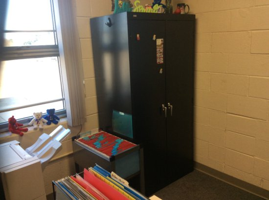 Corner desk and metal filing cabinet. Contents not included